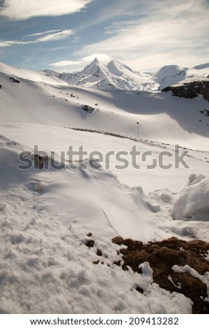 Mountain landscape with snowy mountain peaks