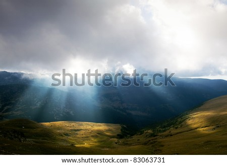 mountain landscape with sun rays in Parang Mountains in Romania