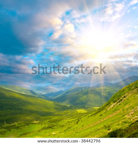 mountain landscape with sunshine in clouds