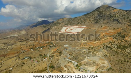 Mountain landscape with the five finger mountain in Cyprus. Mountain top with clouds. Beşparmak Dağları Kıbrıs. Northern Cyprus flag on the five finger mountains Stok fotoğraf ©