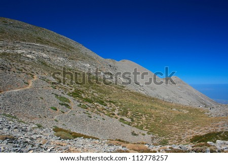 Mountain landscape with the highest mountain of Crete island Psiloritis in the middle of the image