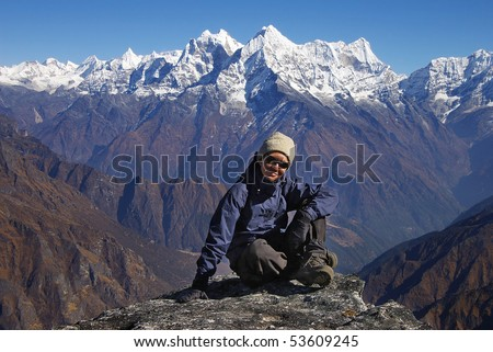 Mountain landscape with the woman on the background of the Himalayas