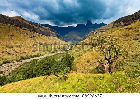 Mountain landscape  with thunder clouds in the backgroud