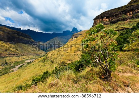 Mountain landscape  with thunder clouds in the background
