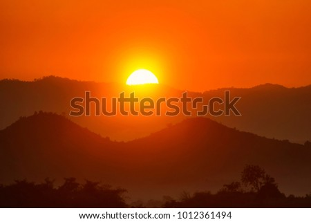 Mountain Mist in sunrise,mist on sunrise,mist over mountain during sunrise #1012361494