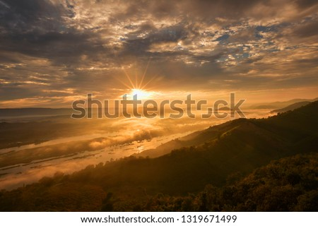 Mountain Mist in sunrise,mist on sunrise,mist over mountain during sunrise #1319671499