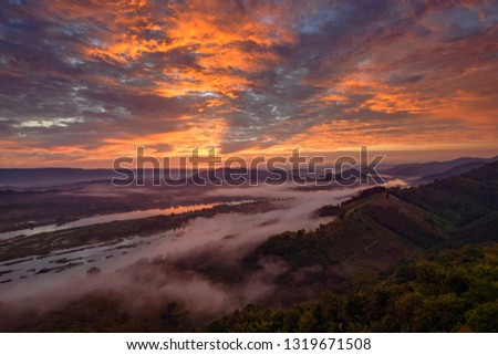 Mountain Mist in sunrise,mist on sunrise,mist over mountain during sunrise #1319671508