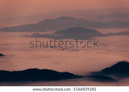 Mountain Mist in sunrise,mist on sunrise,mist over mountain during sunrise.Beautiful landscape in the mountains at sunrise.