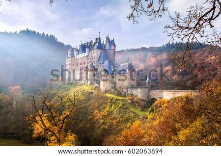 Mountain Neuschwanstein castle landscape in autumn mountain forest