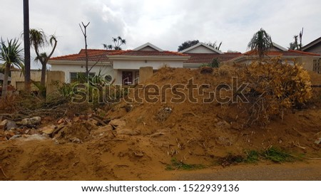 Mountain of Rubble In Front Of The House