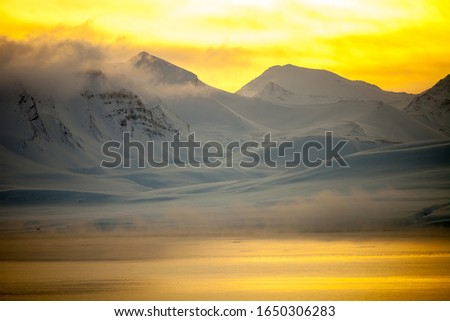 Mountain on the Svalbard archipelago. Sun and white snow. Сток-фото ©