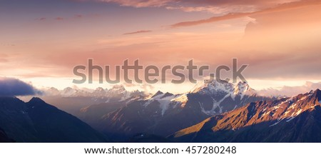 Mountain panorama during sundown. Beautiful natural panoramic landscape in the summer time #457280248