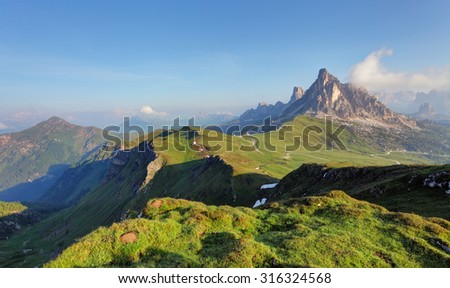 Mountain Panorama of the Dolomites as viewed from passo di Giau (as viewed from the mountain pass Giau). Photograph was taken just after the sunrise from the top of the pass. - Shutterstock ID 316324568