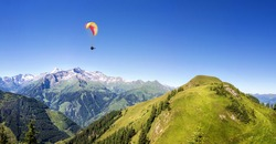 Mountain panorama with paraglider
