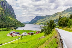 Mountain panorama with typical Norwegian wooden farmhouse in Forde in Sogn og Fjorden county in Norway