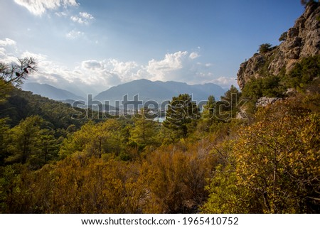 Mountain path between Kemer and Kirish. Top view from the mountain to the sea. Mountain landscape.  A walk in the mountain forest. Trees in the mountains. ストックフォト ©