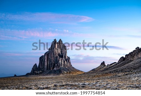 Mountain peak in a mountain valley at dawn. Mountain rock. Mountain rock landscape. Mountain landscape