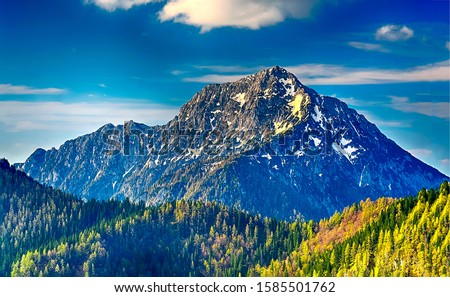 Mountain peak in autumn landscape. Mountain peak view. Mountain peak landscape. Mountain peak snow