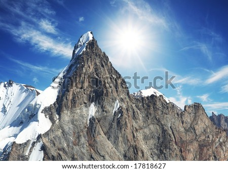 Mountain peak on sunny background