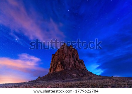 Mountain peak on sunset sky with stars background. Mountain peak sunset view. Sunset mountain peak landscape