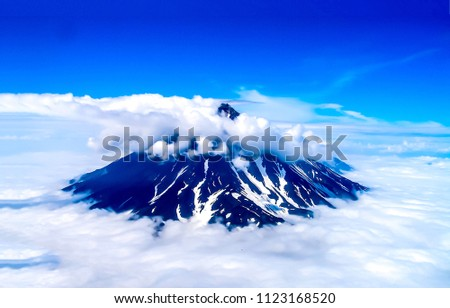 Mountain peak snow in clouds sky panorama. Cloudy mountain peak snow landscape. Mountain peak snow cloudscape view #1123168520