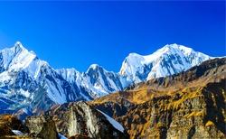 Mountain peak snow landscape. Snowy mountain peak view. Mountain snow peak scene. Mountain