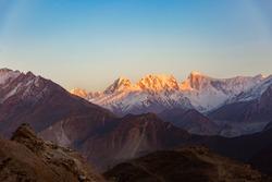 Mountain peak with during sunset on top, Rakaposhi mountain peaks in Pakistan.