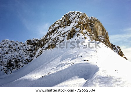 Mountain peak with snow and blue sky