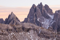 Mountain peaks in alpenglow in dolomites