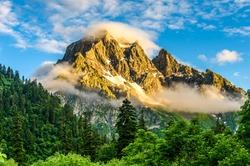 Mountain peaks in fog scenery landscape