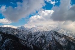 Mountain Peaks of Pamir, Panoramic View. Dramatically Clouded Sky.