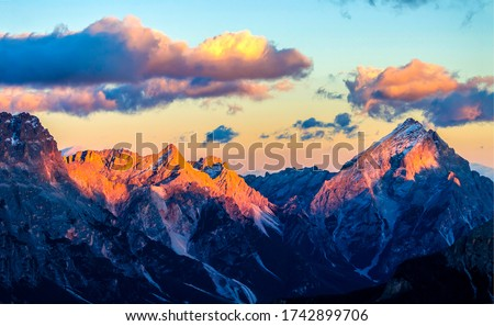 Mountain peaks sunset clouds landscape. Sunset mountain peaks view