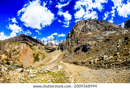 Mountain peaks under the clouds. Mountain blue sky clouds. Cloudy sky in mountains