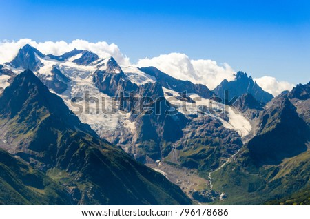 mountain peaks with snow caps on the Caucasus #796478686