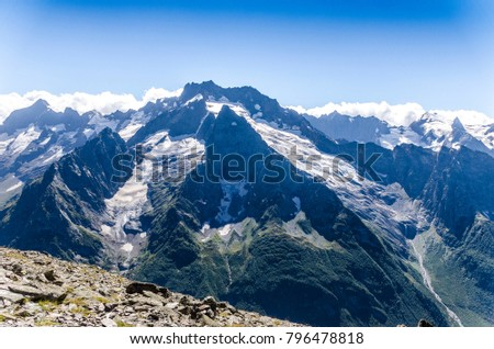Stock Photo mountain peaks with snow caps on the Caucasus