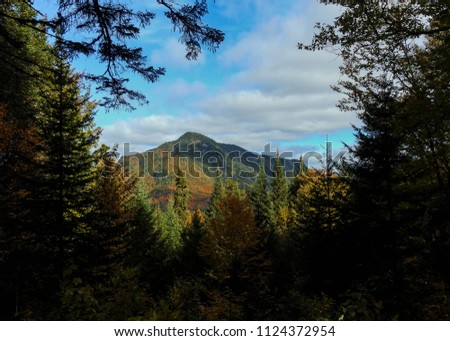 Mountain pic view in autumn at Jacques cartier national park in Quebec Canada