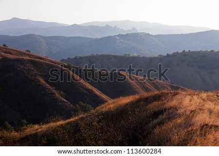 Mountain range in the rays of the rising sun
