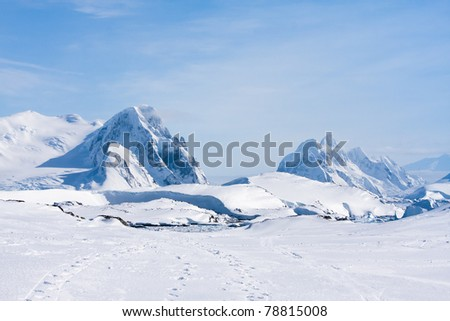 Mountain range is covered with white snow in Antarctica