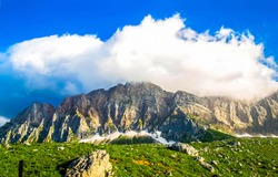 Mountain range peak clouds landscape. Mountain range clouds view. Mountain range landscape. Cloudy sky over mountain range