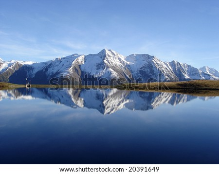 Mountain Reflection Bettmersee Lake In Bernese Alps Switzerland