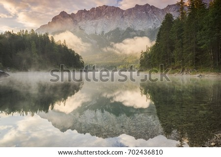 mountain reflection in a lake #702436810