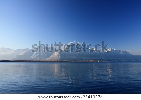 Mountain reflection in Lake Geneva (Leman), Switzerland