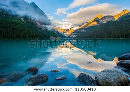 Mountain reflection on lake Louise at sunrise, Banff , canada