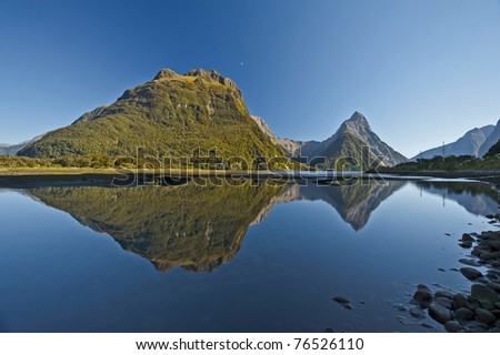 mountain reflection on the water at Milford Sound, New zealand, south island
