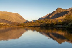 Mountain reflections on LLyn Padarn lake at Llanberis in the Snowdonia area of North Wales UK