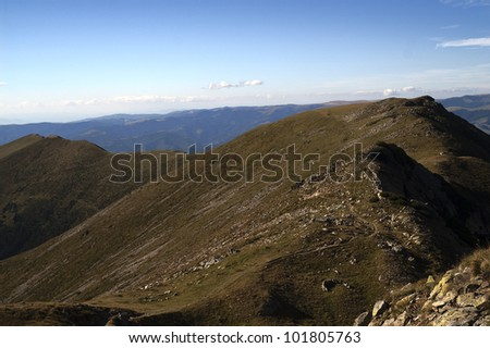 Mountain ridges and slopes viewed from above.