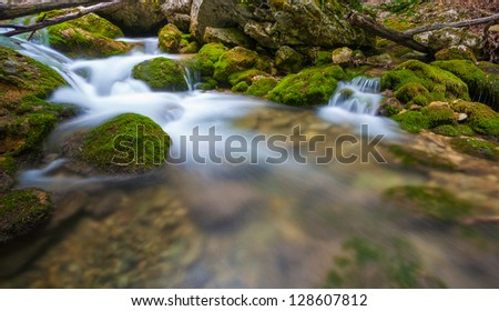 Mountain river. A stream of water in forest and mountain terrain. Crimea, the Grand Canyon. - stock photo