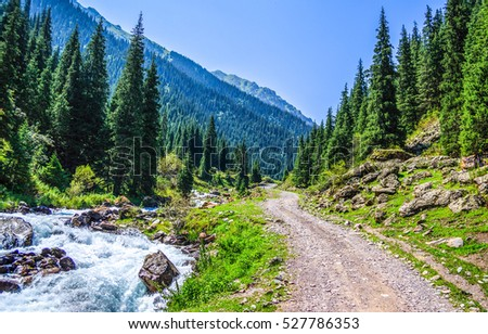Mountain river and mountain road