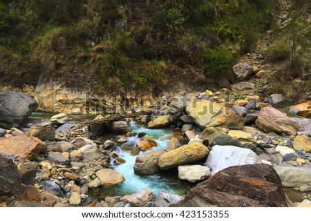 Mountain river and stones, rocky riverbed, ice cold water of mountain river, mountain river photo, mountain river in Nepal, mountain river in Himalaya, crossing mountain river, mountain river image