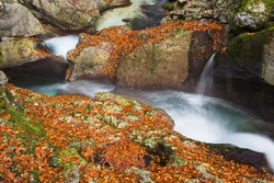 Mountain river gorges and waterfall in autumn colors, Sunik water grove, river Lepenca, Bovec, Slovenia, water background, Soca valley, Triglav national park, Europe